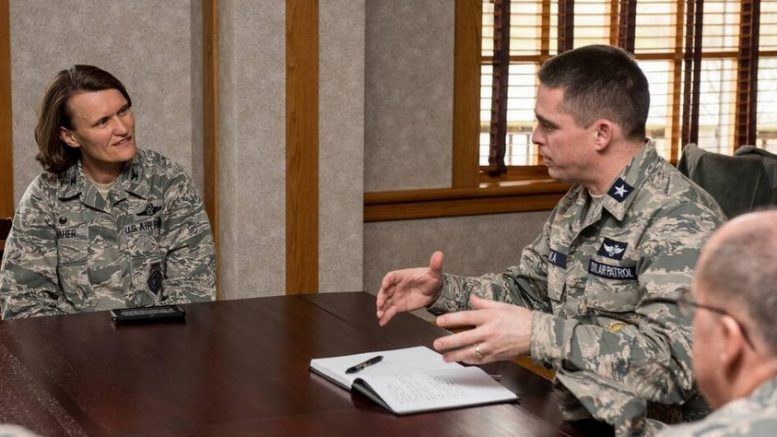 Gen. Edward Phelka, Civil Air Patrol national vice commander, meets with Col. Leslie Maher