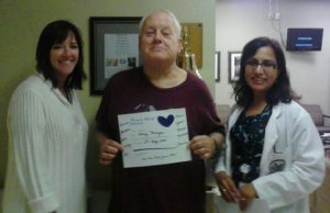 His radiation tech, Skip Munger, and Dr. Talwar his oncologist after his last treatment.