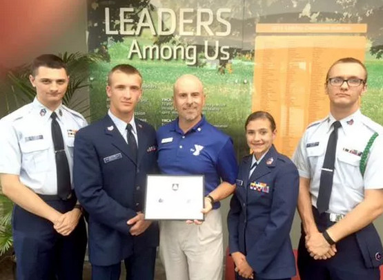 Darin Pickles, center, director of operations for the Lebanon YMCA, receives a certificate of appreciation recently for partnering with U.S. Air Force Auxillary, Civil Air Patrol, Squadron 307 and coordinating winter training sessions indoors. Also pictured are, from left, Cadet Chief Master Sgt. Ryan Mantz. (Source: Lebanon Daily News)