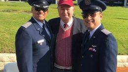 Dana Rohrabacher holds up two Civil Air Patrol Senior Members for show