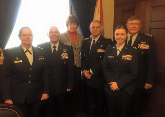 Col Henry Irizarry and Col Michael Cook with Rep. Gwen Graham.