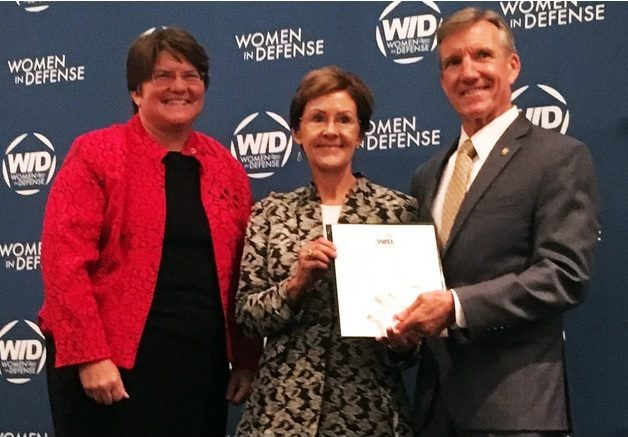 WID President Amy Courter, left and CAP BoG Chair Judith Fedder, center