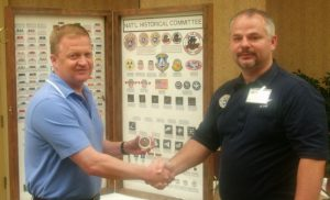Col Eric Boe shakes hands with former CAP active Jim Shaw